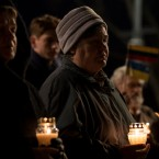 People light candles to mark a day of memory for the victims of the Holodomor in 1932-1933 at the former KGB building in Vilnius, Lithuania, Friday, Nov. 25, 2016.