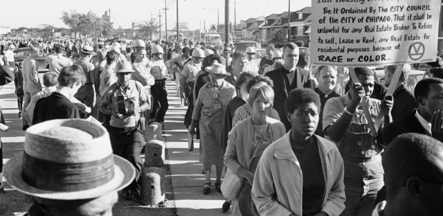 Demonstrators protest housing discrimination by Chicago real estate dealers in 1966. A new study says the city's black families lost between $3 billion and $4 billion in wealth because of predatory housing contracts during the 1950s and 1960s.
