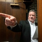 Democratic Cook County Commissioner and village of McCook Mayor Jeff Tobolski leaves a February village board meeting. Tobolski skipped county board meetings for two months after a federal law enforcement raid on McCook's village hall in September.