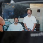 Eric Paddock holds a photo of him, at left, and his brother, Stephen Paddock, at right, outside his home, Monday, Oct. 2, 2017, in Orlando, Fla. Stephen Paddock opened fire on the Route 91 Harvest Festival on Sunday killing dozens and wounding hundreds.