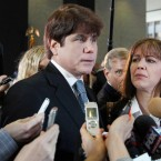 In this Dec. 7, 2011 file photo, former Illinois Gov. Rod Blagojevich, left, speaks to reporters as his wife, Patti, listens at the federal building in Chicago, after Blagojevich was sentenced to 14 years on 18 corruption counts. On Monday, March 28, 2016, the U.S. Supreme Court rejected Blagojevich's appeal of his corruption convictions that included his attempt to sell the vacant Senate seat once occupied by President Barack Obama.