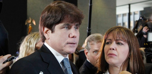 Former Illinois Gov. Rod Blagojevich, left, speaks to reporters as his wife, Patti, listens at the federal building in Chicago, after Blagojevich was sentenced to 14 years on 18 corruption counts . A resentencing hearing is scheduled next month for Blagojevich, who is hoping a federal judge will give him a five-year sentence instead of his original 14 years.