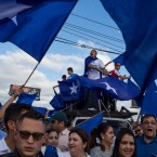 Supporters of Honduran President Juan Orlando Hernandez, who is running for reelection, march to show support for their candidate in Tegucigalpa, Honduras, Tuesday, Nov. 28, 2017.