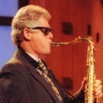 """Bill Clinton plays the saxophone during a campaign stop on """"The Arsenio Hall Show"""" in Los Angeles June 3, 1992."""