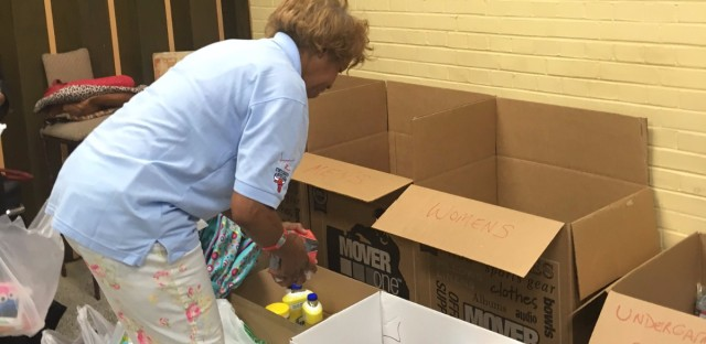 Rainbow PUSH volunteer Pamela Persons sorts out donations going to Louisiana flood victims.