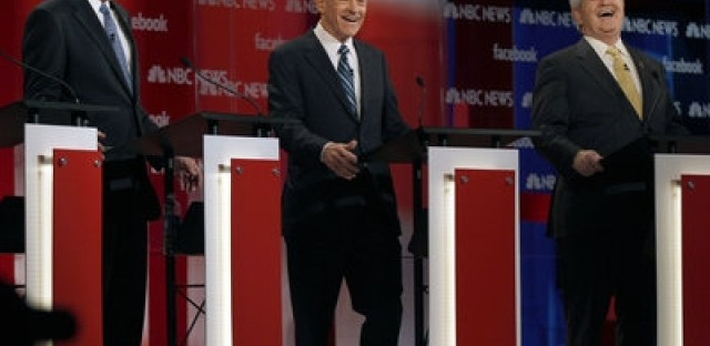 Former Mass. Gov. Mitt Romney, Rep. Ron Paul, R-Texas, and former House Speaker Newt Gingrich at Sunday's Republican debate.