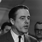 Sargent Shriver, then head of President Lyndon Johnson's poverty program, talks with reporters after appearing before the House Education and Labor Committee on March 8, 1966 in Washington, D.C.