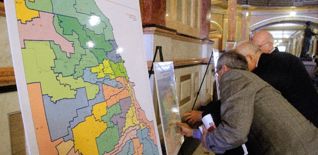Newly proposed redistricting maps are displayed in the hallways of the Illinois State Capitol in Springfield
