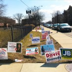 Candidate yard signs shown outside the 4th Ward early voting site.