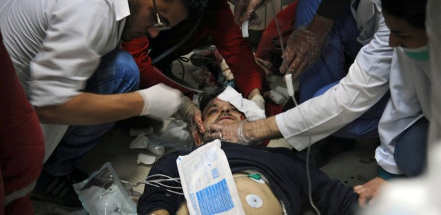 In this photo released by the Syrian official news agency SANA, shows a man receiving treatment at a hospital in Damascus, Syria, Saturday, April. 7, 2018.