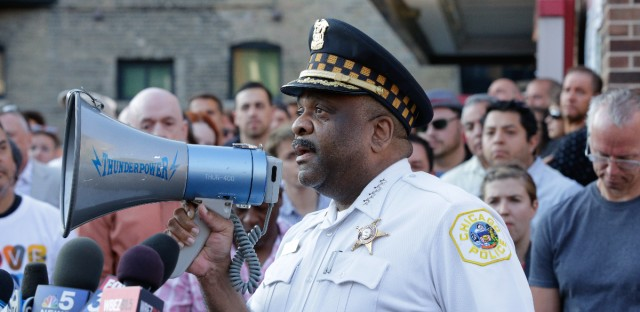Chicago Police Superintendent Eddie Johnson speaks with members of LGBT groups and their supporters at a vigil in the city's Boystown neighborhood on Sunday, June 12, 2016. Johnson said the city has stepped up security in gay communities following the shooting attack at a gay nightclub in Orlando.