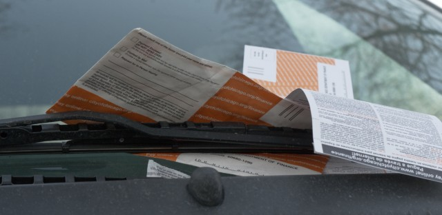 Multiple tickets on a parked vehicle in Chicago.