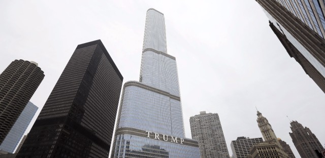 In this Thursday, March 10, 2016, photo is the Trump International Hotel and Tower in Chicago. Republican presidential candidate Donald Trump has pledged to scrap a work visa program that brings 300,000 student workers each year to the U.S. Among the businesses that would be forced to stop hiring foreign labor: Trump's own.