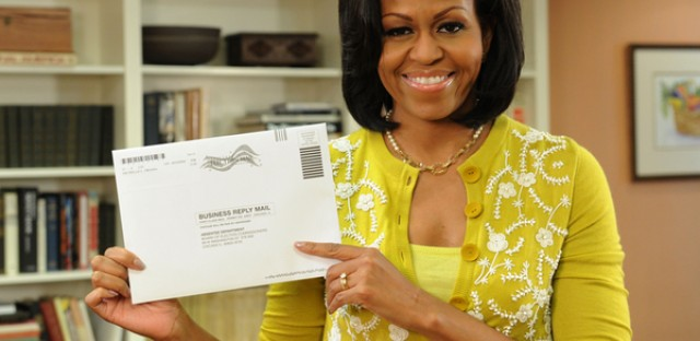 First Lady Michelle Obama prepares her absentee ballot.