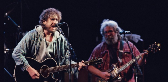 Dylan and Garcia, two musicians Graham was close to, perform at a now-legendary concert Graham put on in Oakland in 1987