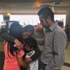 Elena Santizo hugs two of her children at an airport in Tennessee after a nearly three-month separation.