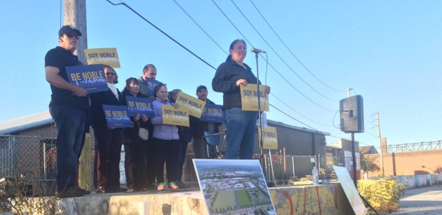 Noble supporters gathered for a small rally this week at the site where they hope the charter network's 17th campus will be built. The school board votes on whether to approve the charter school today.
