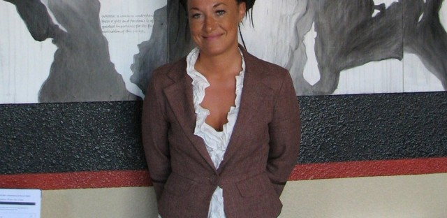 In this July 24, 2009, file photo, Rachel Dolezal, a leader of the Human Rights Education Institute, stands in front of a mural she painted at the institute's offices in Coeur d'Alene, Idaho. Dolezal, now president of the Spokane, Wash., chapter of the NAACP, is facing questions about whether she lied about her racial identity, with her family saying she is white but has portrayed herself as black.