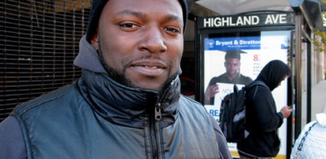 McArthur Edwards at a bus stop he uses to commute. His license was suspended for two years because he was unable to pay a $64 fine.
