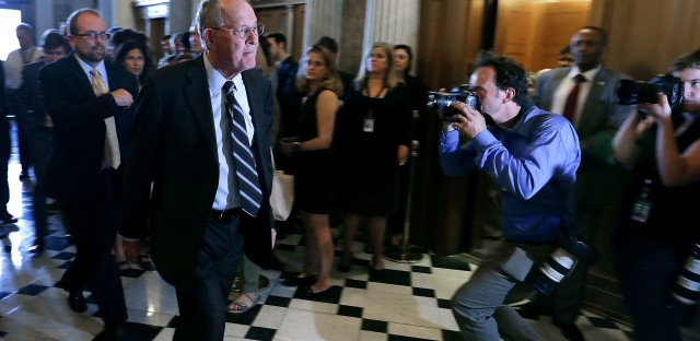 Sen. Lamar Alexander, R-Tenn., walks to the Senate chamber for a vote in the U.S. Capitol on July 26. He and Democratic Sen. Patty Murray of Washington announced Tuesday they would begin to hold health care hearings in September.
