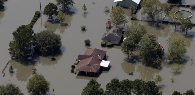 Homes are surrounded by floodwaters in the aftermath of Hurricane Harvey near Beaumont, Texas, on Friday.