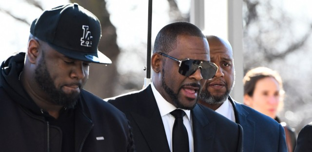R. Kelly, right, arrives at the Leighton Criminal Court for a hearing on Friday, March 22, 2019, in Chicago.