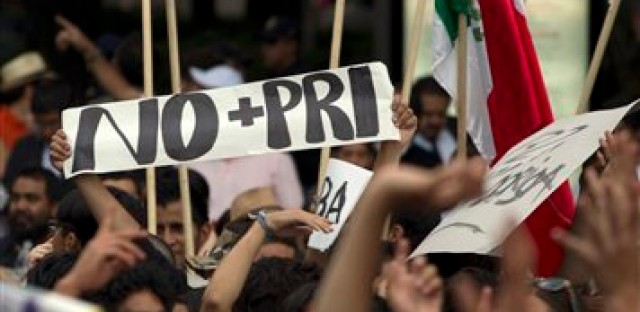 Students demonstrate during a protest against a possible return of the old ruling Institutional Revolutionary Party, PRI, in Mexico City last Wednesday. Mexico will hold presidential elections on July 1.