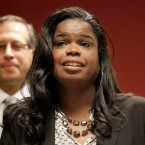 FILE - In this Dec. 2, 2015, file photo, Kim Foxx, then a candidate for Cook County state's attorney, speaks at a news conference in Chicago. Foxx, the Chicago area's top prosecutor says her office is starting a new effort to target gun crimes in city neighborhoods and revamping a branch of her office that investigates possible wrongful convictions. State's Attorney Foxx said Wednesday, March 15, 2017 that attorneys from her office are teaming up with federal prosecutors in two police districts that have some of the highest violence rates.