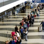 A long line of travelers wait for the TSA security check point at O'Hare International airport, Monday, May 16, 2016, in Chicago. Already faced with lines that snake through terminals out to the curb, fliers are bracing for long waits at security in the busy months of July and August. Some major airports are currently seeing wait times exceeding 90 minutes at peak hours.