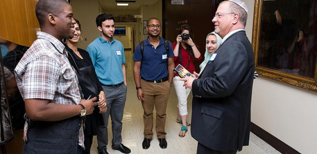 Gerald Hankerson, the outreach coordinator for CAIR-Chicago [left], chats with JCUA board member Kalman Resnick [right], and several others.
