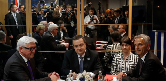 German Foreign Minister Frank-Walter Steinmeier, left, OSCE Chairman and Serbia's Foreign minister Ivica Dacic, center and Switzerland Foreign Minister Didier Burkhalter, right, attend at the Ministerial Troika meeting at the OSCE Ministerial Council, in Belgrade, Serbia, Thursday, Dec. 3, 2015. European leaders warned Thursday that the security situation in Europe remains complex and fragile following the attacks in Paris that killed over 100 people last month. (AP Photo/Darko Vojinovic)