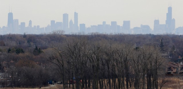 "In this 2015 file photo, a thick haze of smog looms over the skyline of Chicago. A new study in the ""Proceedings of the National Academy of Sciences"" finds that black and Hispanic Americans are at more risk from air pollution mainly caused by white Americans' consumption of goods and services."