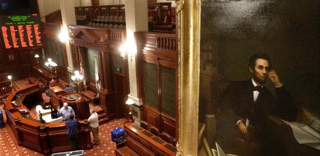 Illinois House of Representative staffers prepare the House chambers for President Barack Obama's visit on Feb. 9, 2016, at the Illinois State Capitol in Springfield.