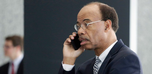 In this July 30, 2015 file photo, former Illinois Congressman Mel Reynolds talks on his cell phone as he leaves federal court in Chicago after pleading not guilty to federal tax charges.