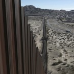 A truck drives near the Mexico-U.S. border fence, on the Mexican side, separating the towns of Anapra, Mexico, and Sunland Park, N.M., Wednesday.