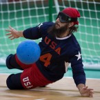 John Kusku of the United States, works to block the ball during the men's preliminary round Group B goalball match against China, during the Rio 2016 Paralympic Games, at Future Arena, in Rio de Janeiro, Brazil, Friday, Sept. 9, 2016. United States won 5 - 2. (AP Photo/Mauro Pimentel)
