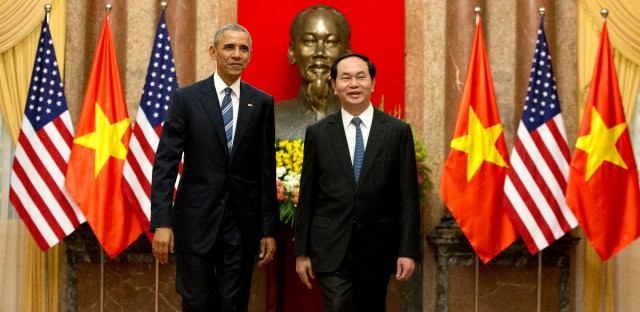 U.S. President Barack Obama, left, and Vietnamese President Tran Dai Quang walk to a meeting after shaking hands at the Presidential Palace in Hanoi, Vietnam. Improved relations between the U.S. and Vietnam must not lead to greater pressure on China or threats to its interests, an official Chinese newspaper said Tuesday, May 24.