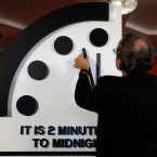 Robert Rosner, chairman of the Bulletin of the Atomic Scientists, moves the minute hand of the Doomsday Clock to two minutes to midnight during a news conference at the National Press Club in Washington, Thursday, Jan. 25, 2018.