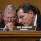 Senate Environment and Public Works Committee Chairman Sen. John Barrasso, R-Wyo., right, confers with Sen. James Inhofe, R-Okla. on Capitol Hill in Washington, Wednesday, Jan. 18, 2017, during the committee's confirmation hearing for Environmental Protection Agency Administrator-designate, Oklahoma Attorney General Scott Pruitt. (AP Photo/J. Scott Applewhite)