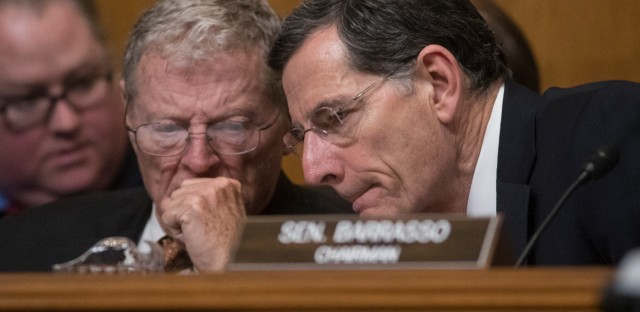 Senate Environment and Public Works Committee Chairman Sen. John Barrasso, R-Wyo., right, confers with Sen. James Inhofe, R-Okla. on Capitol Hill in Washington, Wednesday, Jan. 18, 2017, during the committee's confirmation hearing for Environmental Protection Agency Administrator-designate, Oklahoma Attorney General Scott Pruitt.