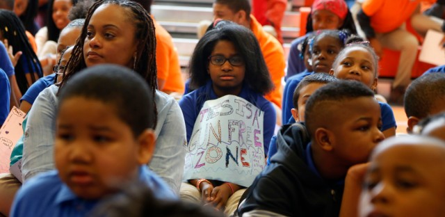 "A young student holds a sign that says ""This Is a Gun Free Zone"" during a Day of Peace rally at Chicago's Legacy Charter School on Friday, April 20, 2018."