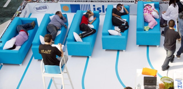 A judge watches contestants sleep during the Siesta Championship in Madrid in 2010. Prime Minster Mariano Rajoy said it's time to end the afternoon break. Many Spaniards call it an outdated stereotype and have been annoyed with the way the foreign media has reported it.