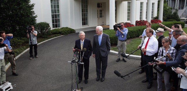 Senate Majority Leader Mitch McConnell, R-K.Y. (left), and Senate Majority Whip John Cornyn, R-Texas, speak to members of the media outside the West Wing of the White House on Tuesday in Washington, D.C. (Alex Wong/Getty Images)