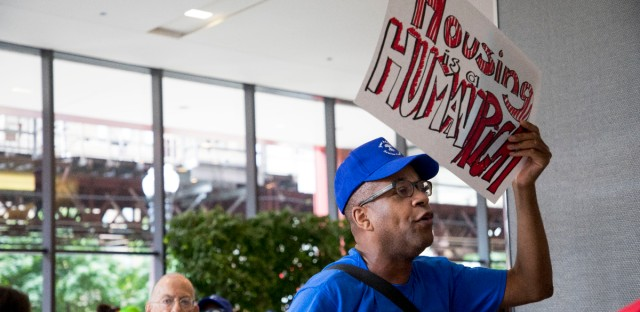 Seniors march out of the Chicago Housing Authority headquarters