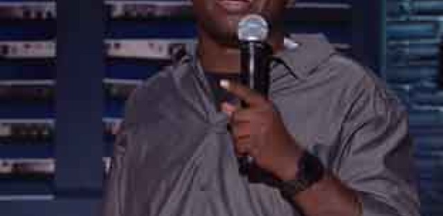 Buress performing stand-up for a Comedy Central special.