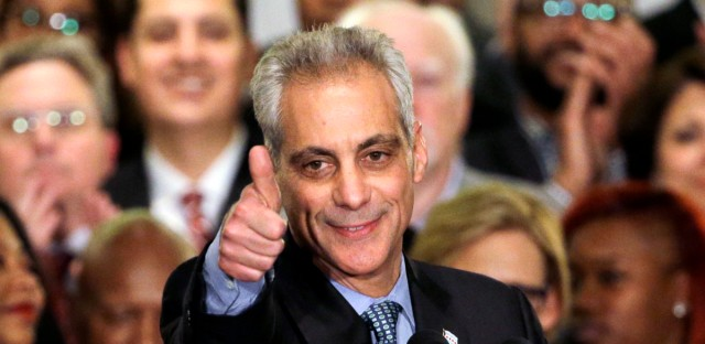 In this April 7, 2015, file photo, Chicago Mayor Rahm Emanuel celebrates at Plumbers Local 130 Union Hall in Chicago after winning in a runoff election for a second term in office.