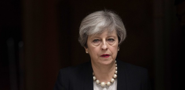British Prime Minister Theresa May leaves 10 Downing Street after addressing the media in London on Tuesday.