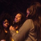 Karla Lee speaks to a crowd at a Chicago Police Department community meeting on Tuesday night near Dawes Park on the city's South Side. Lee's 9-year-old Tyshawn Lee was shot to death in an alley near his home Monday.