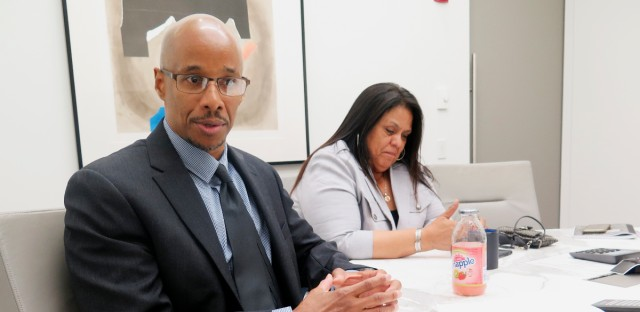 In this June 28, 2017, photo, Patrick Pursley and his fiancee, Michelle Carr, talk in his attorney's office in Chicago about how reexamination of ballistic evidence helped him get a new trial for a 1994 murder he says he didn't commit. The case marks the first time someone has gotten a new trial by using a ballistics software that investigators have been using to put countless criminals behind bars. Pursley is free on bail and living with his fiancee while he waits for a new trial.