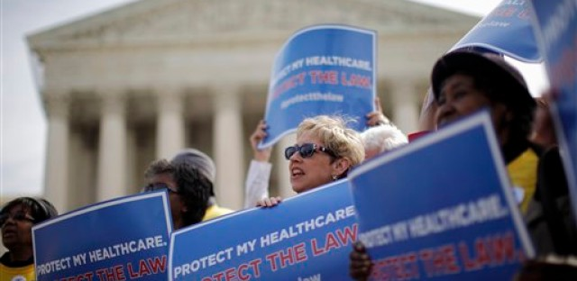 Pro-Affordable Care Act protesters rally outside the Supreme Court